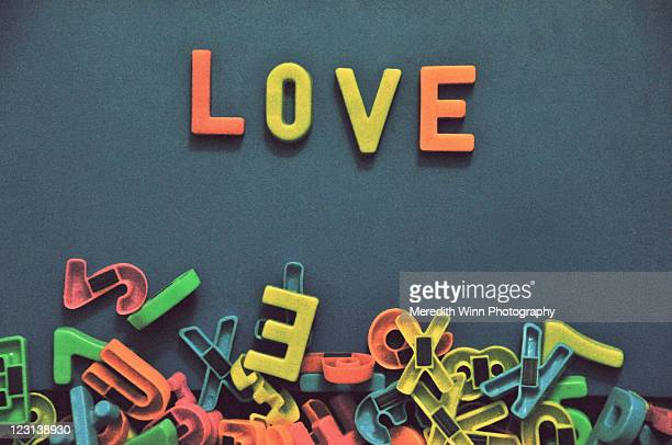Alphabet magnet letters spell love