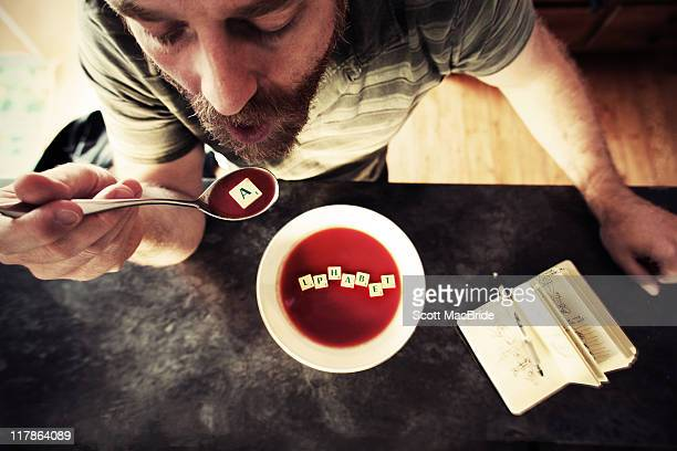 alphabet soup - scott macbride stock pictures, royalty-free photos & images