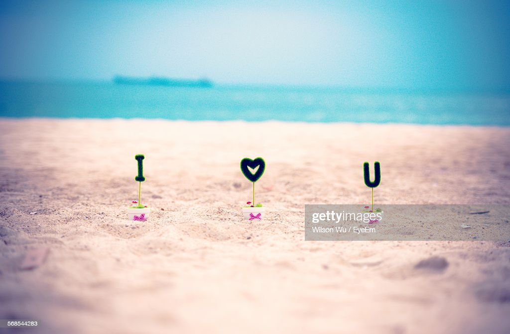 Alphabets And Heart Shape On Pots At Beach : Stock Photo