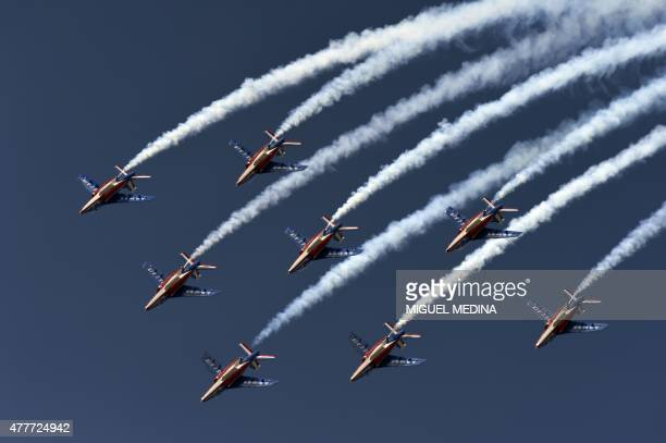 """Alphajet aircrafts from the French elite acrobatic flying team """"Patrouille de France"""" perform during the first public day at the International Paris..."""