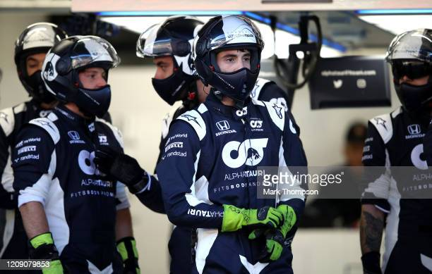 AlphaTauri team members look on from the garage during Day Two of F1 Winter Testing at Circuit de BarcelonaCatalunya on February 27 2020 in Barcelona...