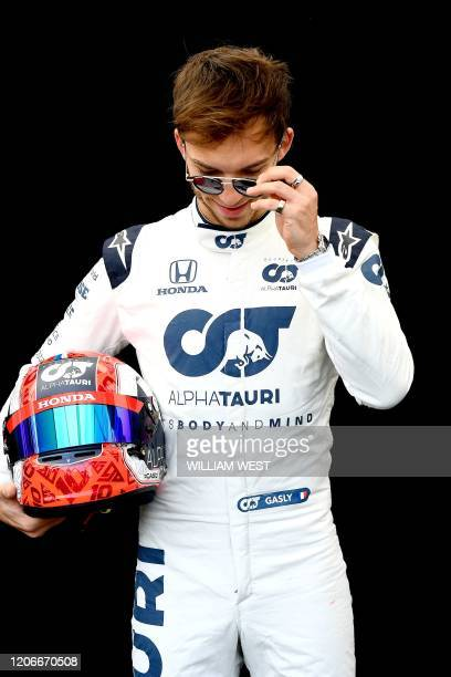 AlphaTauri's French driver Pierre Gasly poses for a photo at the Albert Park circuit ahead of the Formula One Australian Grand Prix in Melbourne on...