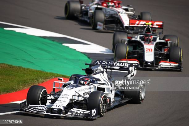 AlphaTauri's Russian driver Daniil Kvyat leads Haas F1's Danish driver Kevin Magnussen through a corner during the F1 70th Anniversary Grand Prix at...