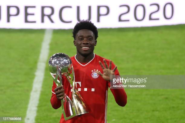 Alphonos Davies of FC Bayern Muenchen celebrates with the Supercup trophy after the Supercup 2020 match between FC Bayern München and Borussia...