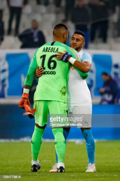 Alphonse Areola and Dimitri Payet of Olympique de Marseille react during the ligue 1 match between Olympique de Marseille and Paris Saint Germain at...