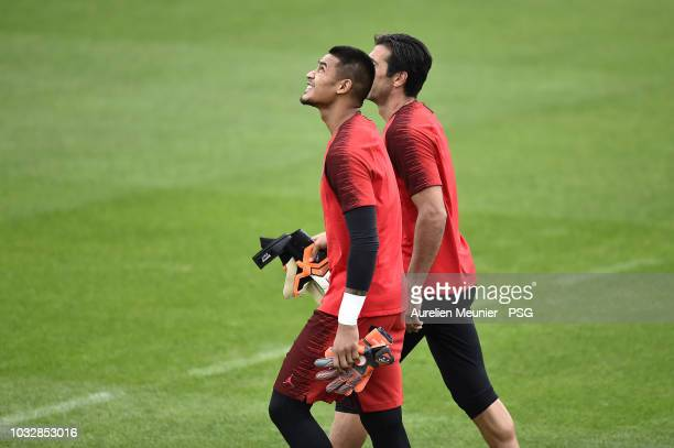 Alphonse Areola and Gianluigi Buffon react during a Paris SaintGermain training session at Centre Ooredoo on September 13 2018 in Paris France