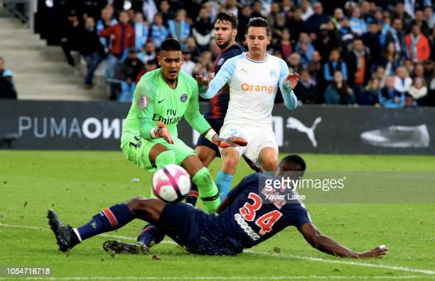 Alphonse Areola and Stanley Nsoki of Paris SaintGermain in action with Florian Thauvin during the French Ligue 1 match between Olympique Marseille...
