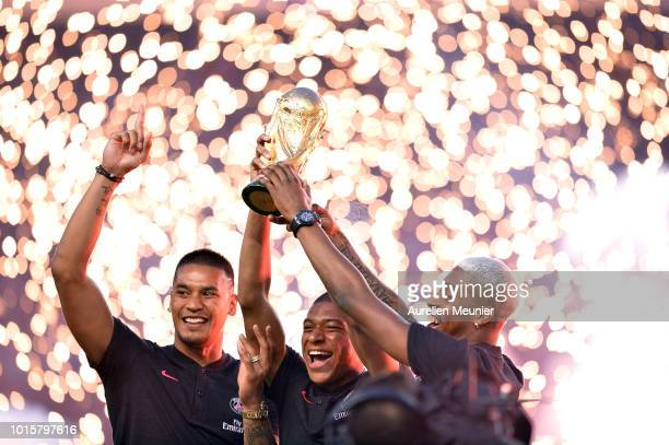 Alphonse Areola Kylian Mbappe and Presnel Kimpembe of Paris SaintGermain celebrate their World Cup victory before the Ligue 1 match between Paris...
