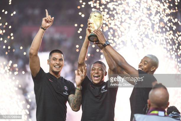 Alphonse Areola Kylian Mbappe and Presnel Kimpembe of PSG with the world cup trophy during the French Ligue 1 match between Paris Saint Germain and...
