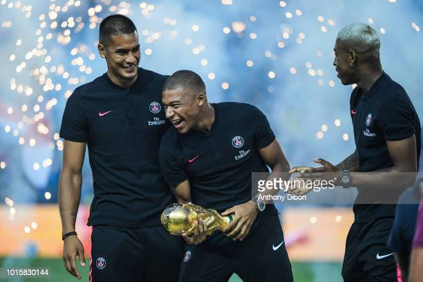 Alphonse Areola Kylian Mbappe and Presnel Kimpembe pose with the world cup trophy during the French Ligue 1 match between Paris Saint Germain and...