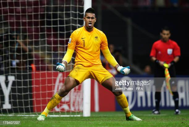 Alphonse Areola of France celebrates after saving a penalty during a shootout during the FIFA U20 World Cup Final match between France and Uruguay at...