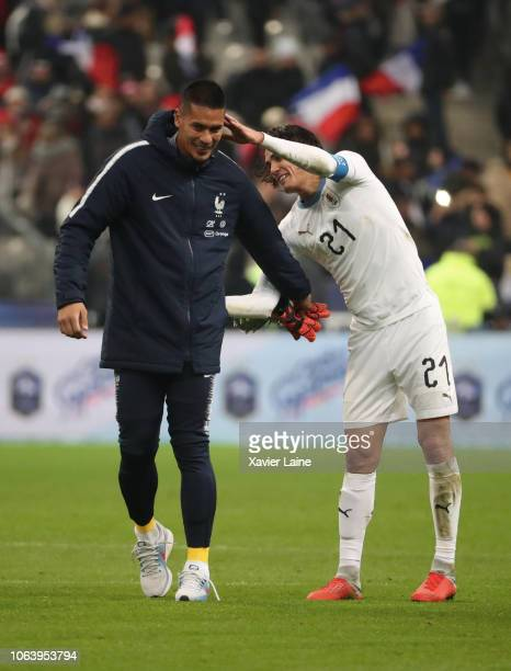 Alphonse Areola of France react with Edinson Cavani of Uruguay after the International Friendly match between France and Uruguay at Stade de France...