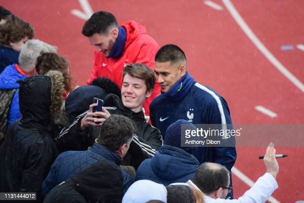 Alphonse Areola of France takes a selfie with fan during the France training session at Centre National du Football on March 18 2019 in...