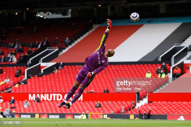 Alphonse Areola of Fulham fails to save a shot by Edinson Cavani of Manchester United as he goes on to score his side's first goal during the Premier...