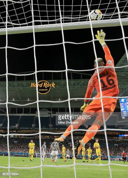 Alphonse Areola of Paris SaintGermain makes a save during the International Champions Cup 2017 match against the Juventus at Hard Rock Stadium on...