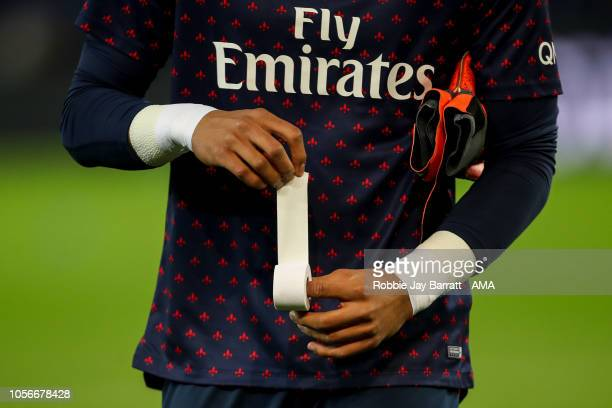 Alphonse Areola of Paris SaintGermain / PSG applies tape to his fingers prior to the Ligue 1 match between Paris SaintGermain and Lille at Parc des...