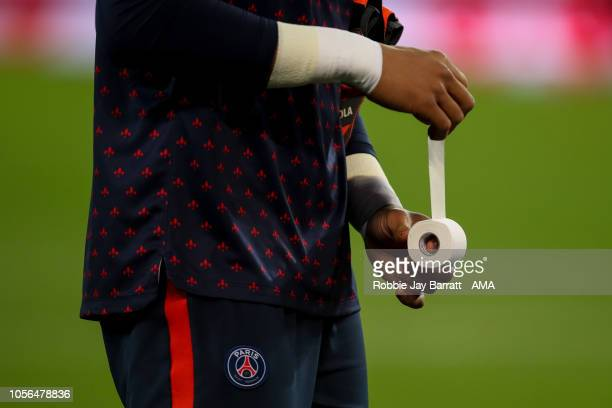 Alphonse Areola of Paris SaintGermain / PSG tapes up his fingers prior to the Ligue 1 match between Paris SaintGermain and Lille at Parc des Princes...