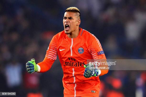 Alphonse Areola of Paris SaintGermain reacts after his side scored their first goal during the UEFA Champions League Round of 16 Second Leg match...