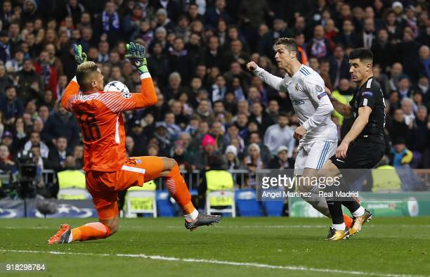 Alphonse Areola of Paris SaintGermain saves a shot from Cristiano Ronaldo of Real Madrid during the UEFA Champions League Round of 16 First Leg match...