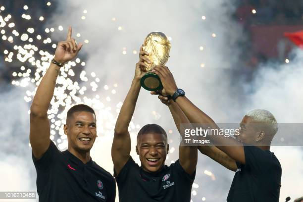 Alphonse Areola of Paris St Germain Kylian Mbappe of Paris St Germain and Presnel Kimpembe of Paris St Germain with the world cup trophy during the...