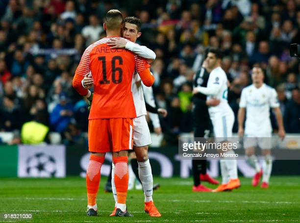 Alphonse Areola of PSG and Cristiano Ronaldo of Real Madrid embrace after during the UEFA Champions League Round of 16 First Leg match between Real...