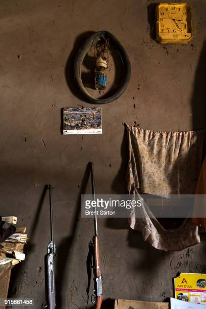 Alphonse Saboundou a teacher who supplements his meagre income with bushmeat hunting is seen recovering from his injuries at the hands of Seleka in...
