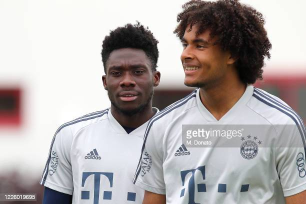 Alphonso Davies and Joshua Zirkzee of FC Bayern Muenchen smile during a training session at Saebener Strasse training ground on May 20 2020 in Munich...