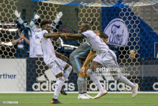 Alphonso Davies and teammate Kei Kamara of the Vancouver Whitecaps celebrate a goal against Minnesota United at BC Place on July 28 2018 in Vancouver...