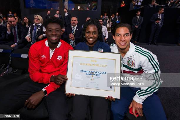 Alphonso Davies Brianna Pinto and Diego Lainez pose after the announcement that the 2026 FIFA World Cup will be held in the United States Mexico and...