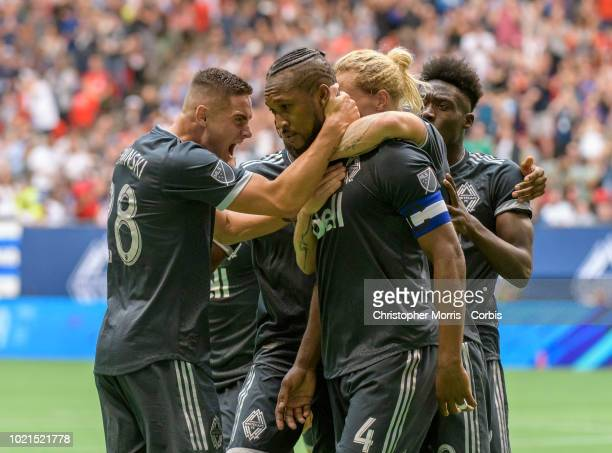 Alphonso Davies celebrates with teammates Kendall Waston Brek Shea and Jake Nerwinski of the Vancouver Whitecaps after scoring a goal at BC Place on...