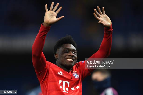 Alphonso Davies FC Bayern Munich shows appreciation to the fans after the UEFA Champions League round of 16 first leg match between Chelsea FC and FC...