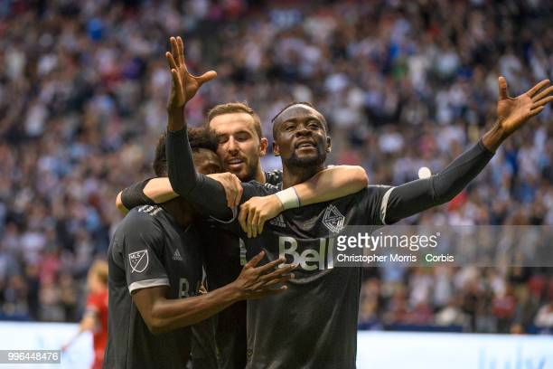 Alphonso Davies Jordon Mutch and Kei Kamara of the Vancouver Whitecaps FC celebrate Kamara's goal against the Chicago Fire at BC Place on July 7 2018...