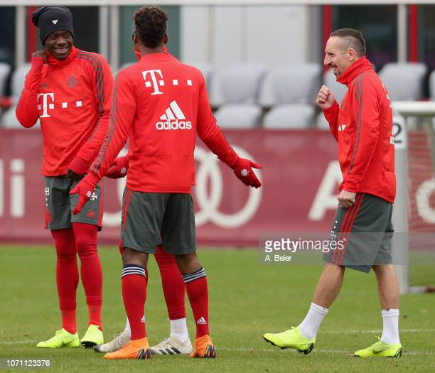 Alphonso Davies Kingsley Coman and Franck Ribery of FC Bayern Muenchen joke during a training session at the club's Saebener Strasse training ground...
