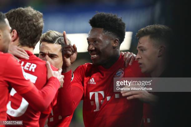 Alphonso Davies of Bayern celebrates providing the assist for the 3rd goal during the UEFA Champions League round of 16 first leg match between...