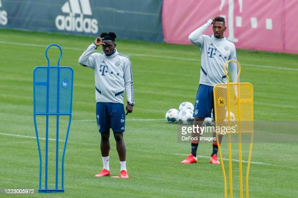 Alphonso Davies of Bayern Muenchen and Jerome Boateng of Bayern Muenchen look on during the FC Bayern Muenchen Training Session on May 05 2020 in...