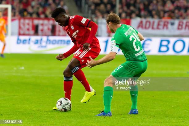 Alphonso Davies of Bayern Muenchen and Tony Jantschke of Borussia Moenchengladbach battle for the ball during the Telekom Cup 2019 Final between FC...
