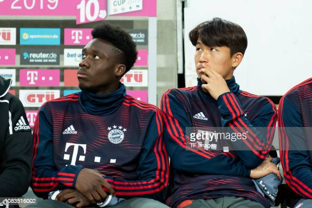 Alphonso Davies of Bayern Muenchen and Wooyeong Jeong of Bayern Muenchen on the bench during the Telekom Cup Semifinal match between Fortuna...
