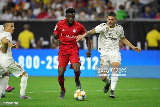Alphonso Davies of Bayern Muenchen battles for the ball with Adrian de la Fuente of Real during the International Champions Cup match between Bayern...