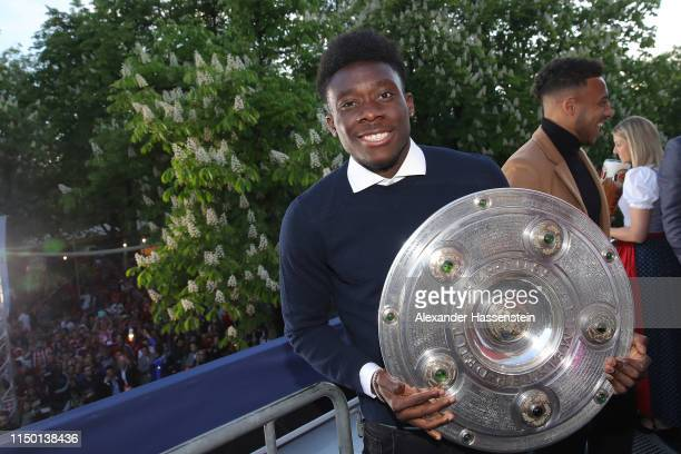 Alphonso Davies of Bayern Muenchen celebrates winning the German Championship title during the Fanfest at Paulaner am Nockherberg on May 18 2019 in...