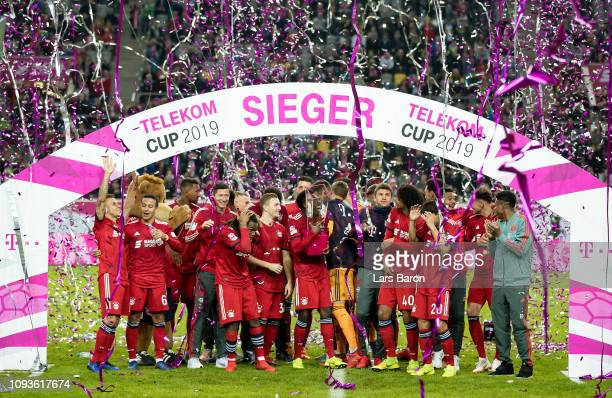 Alphonso Davies of Bayern Muenchen celebrates with the trophy after winning the Telekom Cup 2019 Final between FC Bayern Muenchen and Borussia...