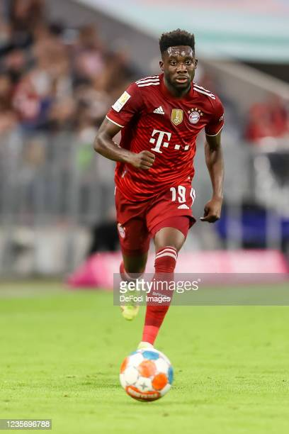 Alphonso Davies of Bayern Muenchen controls the ball during the Bundesliga match between FC Bayern Muenchen and Eintracht Frankfurt at Allianz Arena...