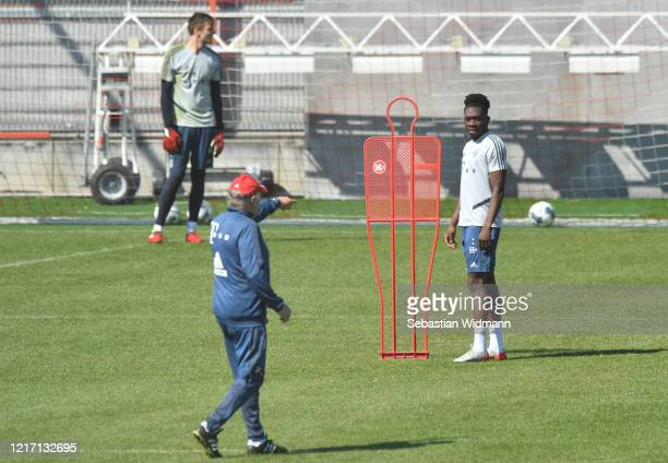 Alphonso Davies of Bayern Muenchen looks on during a training session at Saebener Strasse training ground on April 06 2020 in Munich Germany