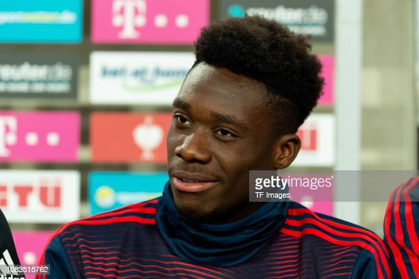 Alphonso Davies of Bayern Muenchen looks on during the Telekom Cup Semifinal match between Fortuna Duesseldorf and Bayern Muenchen at Merkur...