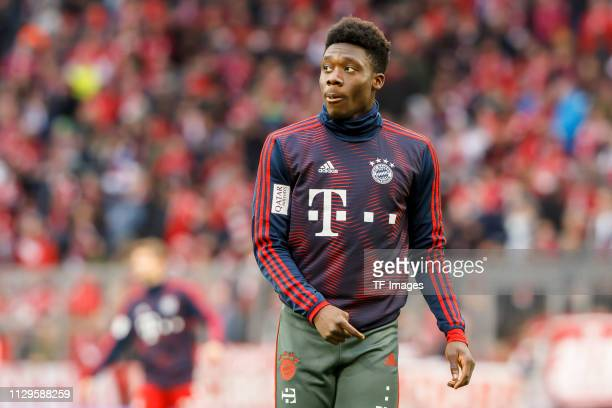 Alphonso Davies of Bayern Muenchen looks on prior to the Bundesliga match between FC Bayern Muenchen and VfL Wolfsburg at Allianz Arena on March 09...