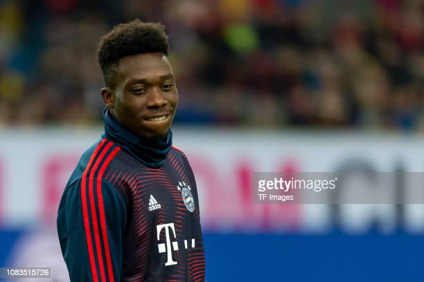 Alphonso Davies of Bayern Muenchen looks on prior to the Telekom Cup Semifinal match between Fortuna Duesseldorf and Bayern Muenchen at Merkur...