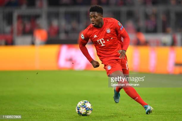 Alphonso Davies of Bayern Muenchen plays the ball during the UEFA Champions League group B match between Bayern Muenchen and Tottenham Hotspur at...