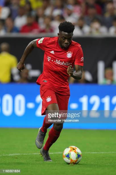 Alphonso Davies of Bayern Muenchen runs with the ball during the International Champions Cup match between Bayern Muenchen and Real Madrid in the...