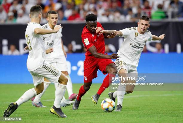 Alphonso Davies of Bayern Munich battles for the ball against Real Madrid in the 2019 International Champions Cup at NRG Stadium on July 20 2019 in...