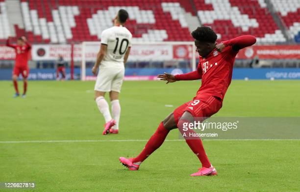 Alphonso Davies of Bayern Munich celebrates after he scores his teams fourth goal during the Bundesliga match between FC Bayern Muenchen and...