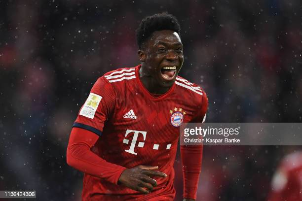 Alphonso Davies of Bayern Munich celebrates scoring his teams sixth goal of the game during the Bundesliga match between FC Bayern Muenchen and 1 FSV...